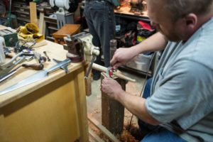 Rob fits the haft to the socket with a spokeshave